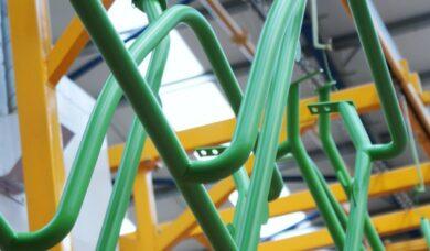 Powder coated bent fabricated tube
