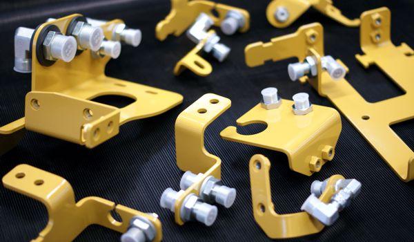 Assembled hydraulic hose brackets